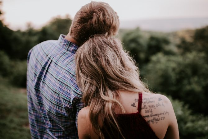 couple standing on mountain, dating