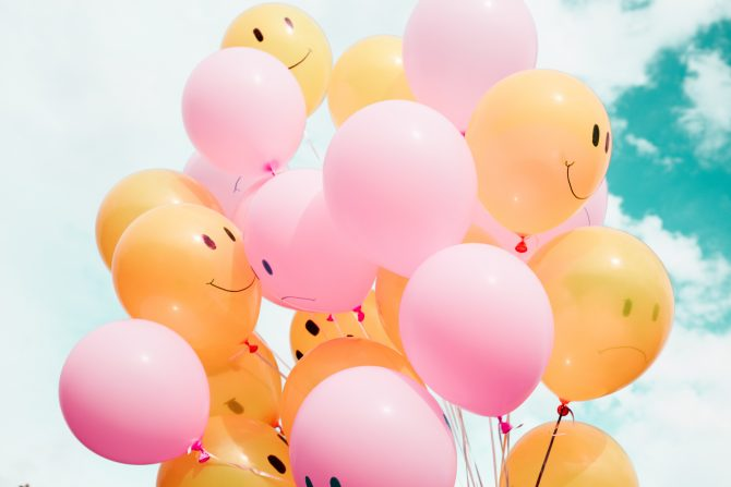 low-angle photo of pink and orange balloons, crowdfunding