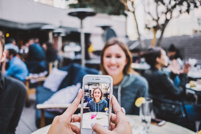 person taking photo of woman, personal branding