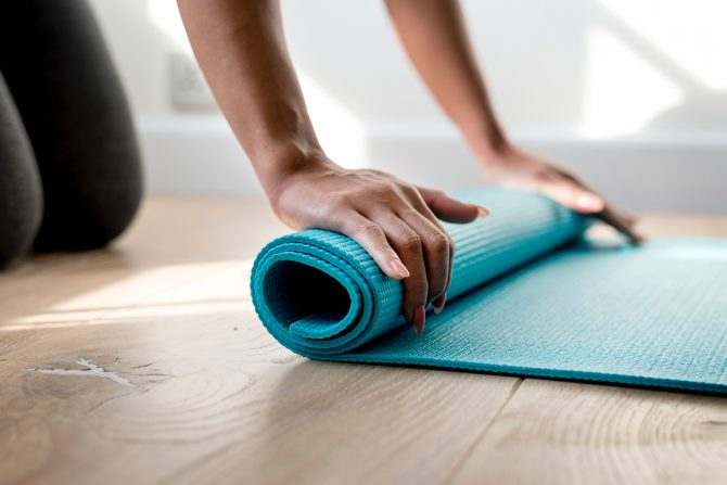 rolling up blue yoga mat