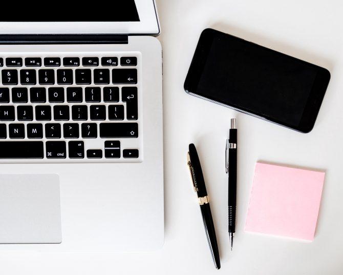 macbook, notebook and pens