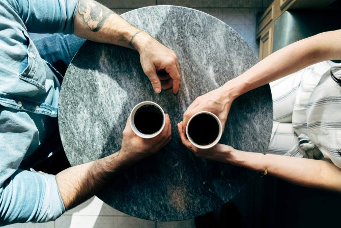 two people having coffee, interview