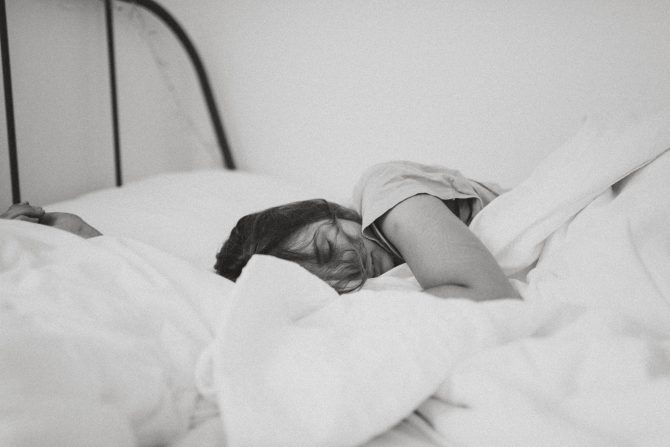 black and white image of woman sleeping