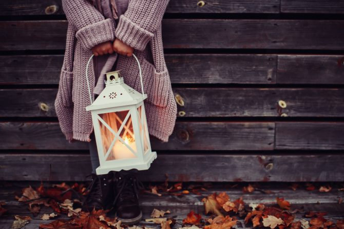 woman holding lamp autumn