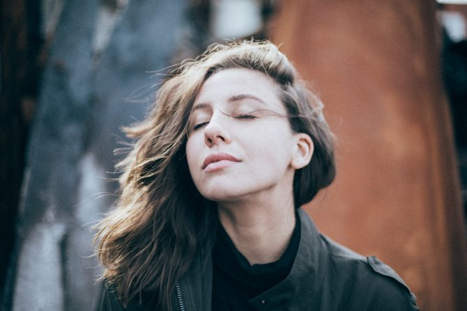 woman breathing with eyes closed