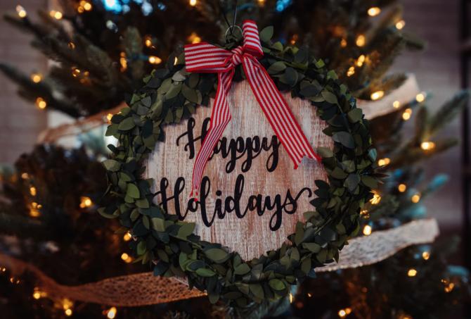 holiday debt, happy holidays wreath